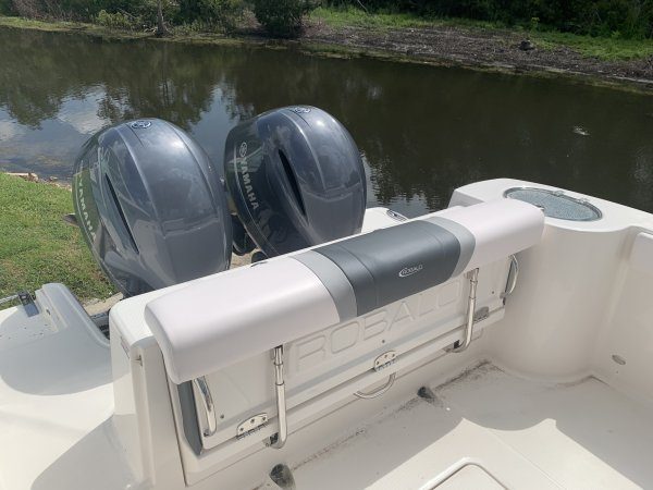 Generally, a Sportfisherman will be a large craft with a fly bridge and outriggers designed to pursue big game fish.  These will be 35 feet up in length and contain all of the amenities to handle heavy blue water.